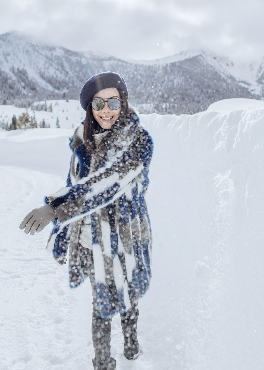 Street style fashion and travel blogger influencer Jenny Tsang of Tsangtastic wearing KAREN MILLEN Faux Fur Coat, JOCELYN Fox Selections Vest, HUDSON Denim Boyfriend Jacket, ELIZABETH AND JAMES Watts Sunglasses and LA CANADIENNE boots, in Mammoth Lakes, California.