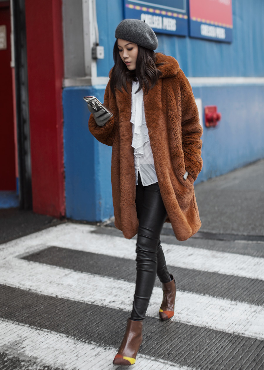 Street style fashion blogger influencer Jenny Tsang of Tsangtastic wearing KAREN MILLEN Teddy Fur Coat, KAREN MILLEN Ruffle Shirt, VINCE Leather Pant, Grey Wool Beret and PERLA FORMENTINI Mia Patchwork Pointy Ankle Boot during New York Fashion Week.