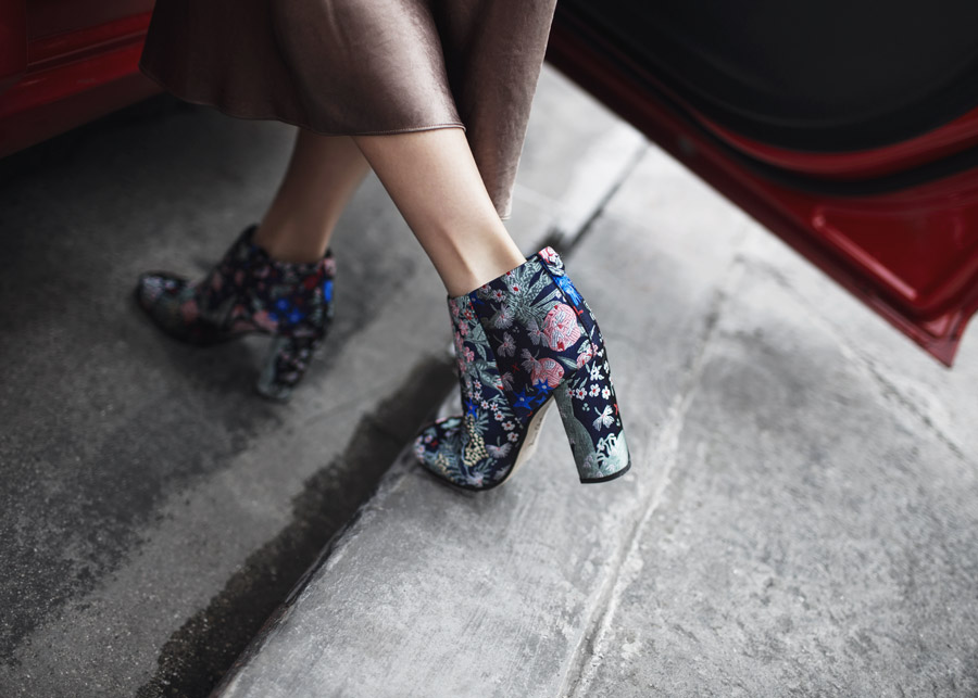 Street style fashion blogger influencer Jenny Tsang of Tsangtastic wearing Vince Satin Skirt, DANSE LENTE bag and SAM EDELMAN Cambell Heeled Bootie in Multi Floral in Los Angeles, California.