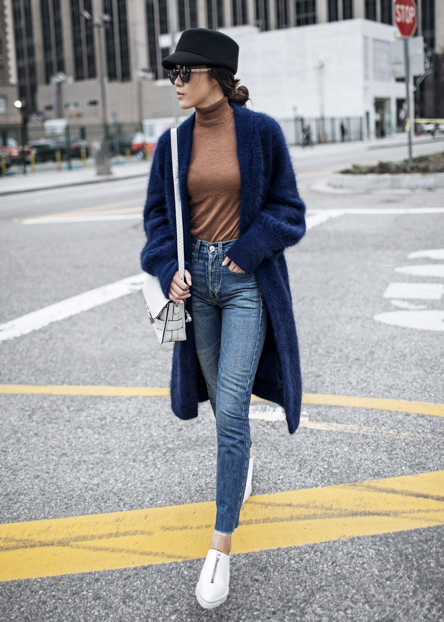 Street style fashion blogger influencer Jenny Tsang of Tsangtastic wearing BYTSANG Fuzzy Cardigan Coat in Navy, VINCE sneakers, PAIGE Straight Jeans, in Los Angeles, California.