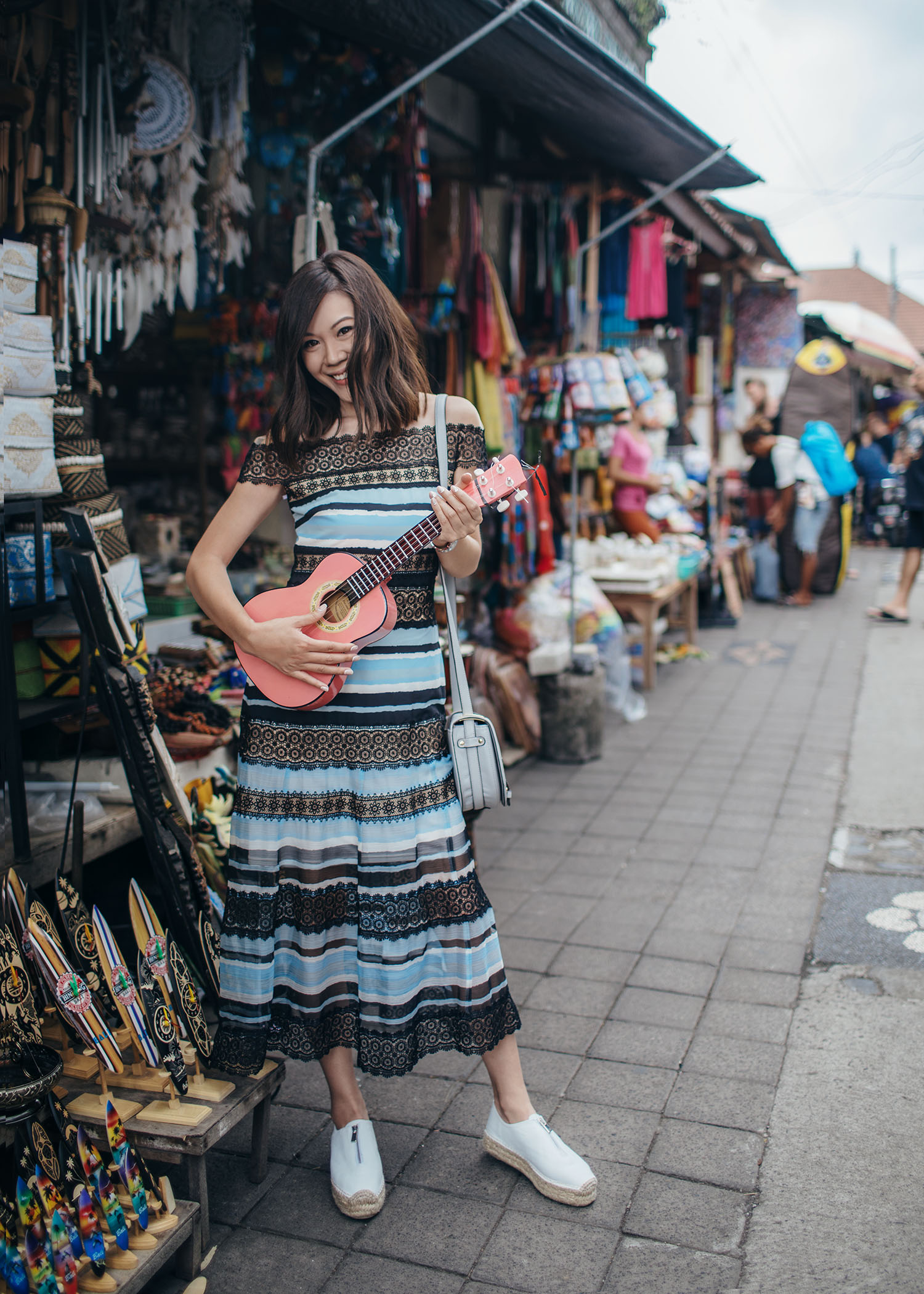 Fashion and travel blogger influencer Jenny Tsang of Tsangtastic traveling in Bali, Indonesia, wearing TADASHI SHOJI Dress, at Ubud Market.