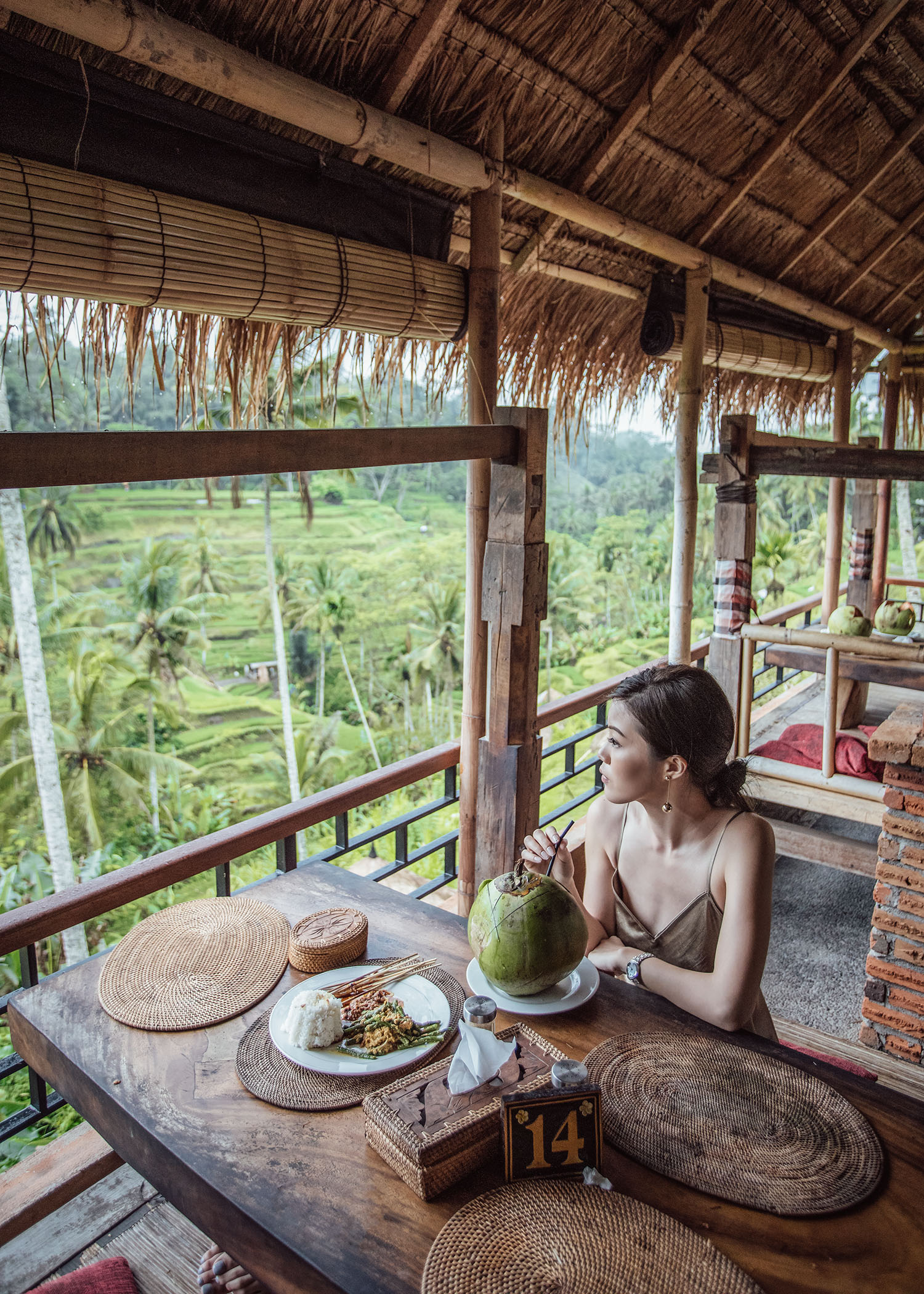 Fashion and travel blogger influencer Jenny Tsang of Tsangtastic traveling in Bali, Indonesia, wearing VINCE Satin Slip Dress Swim, at Rice Terrace.