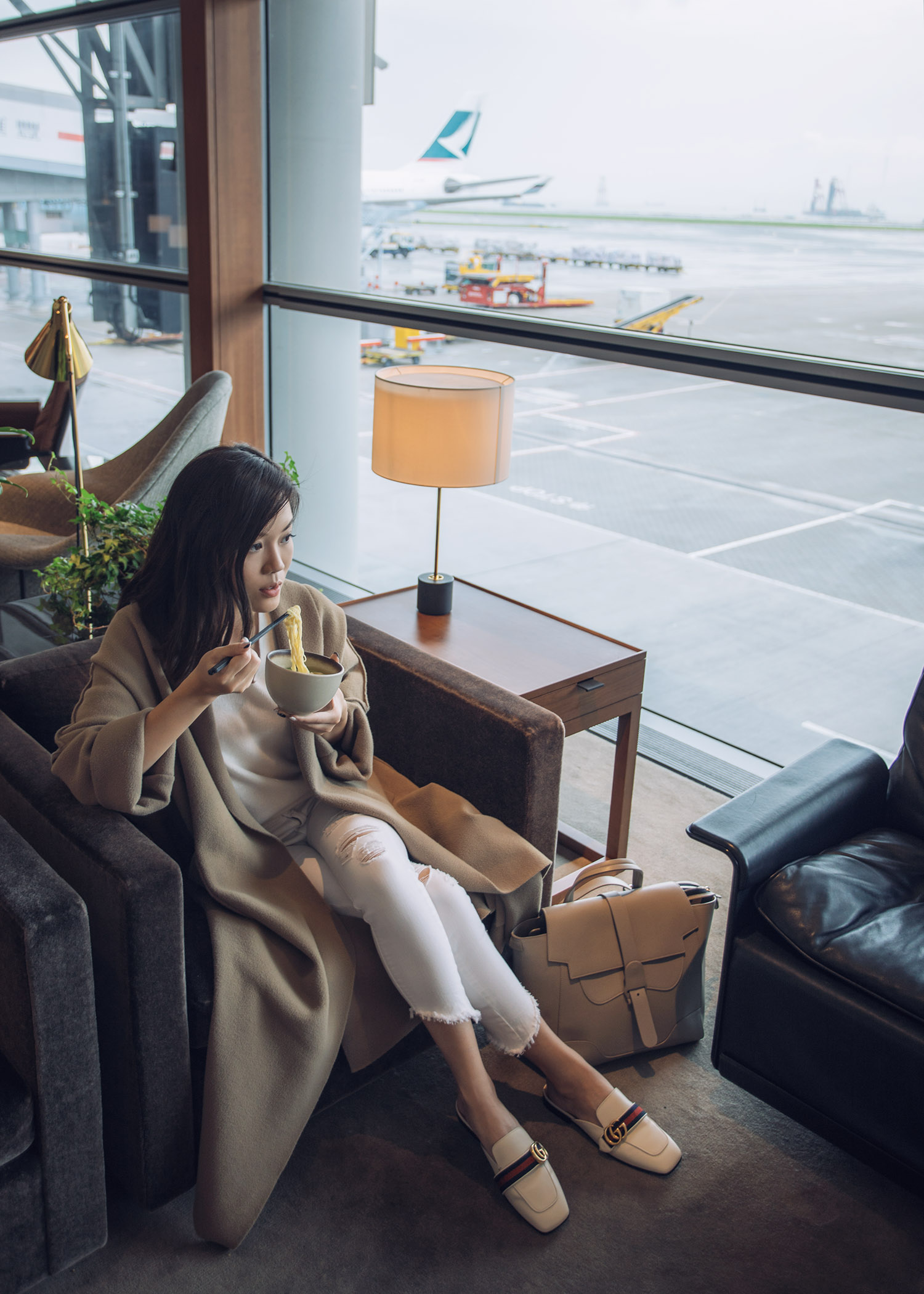 Fashion and travel blogger influencer Jenny Tsang of Tsangtastic traveling in Hong Kong, with Cathay Pacific, wearing Vince Cashmere Sweater and Gucci White Leather Slipper.