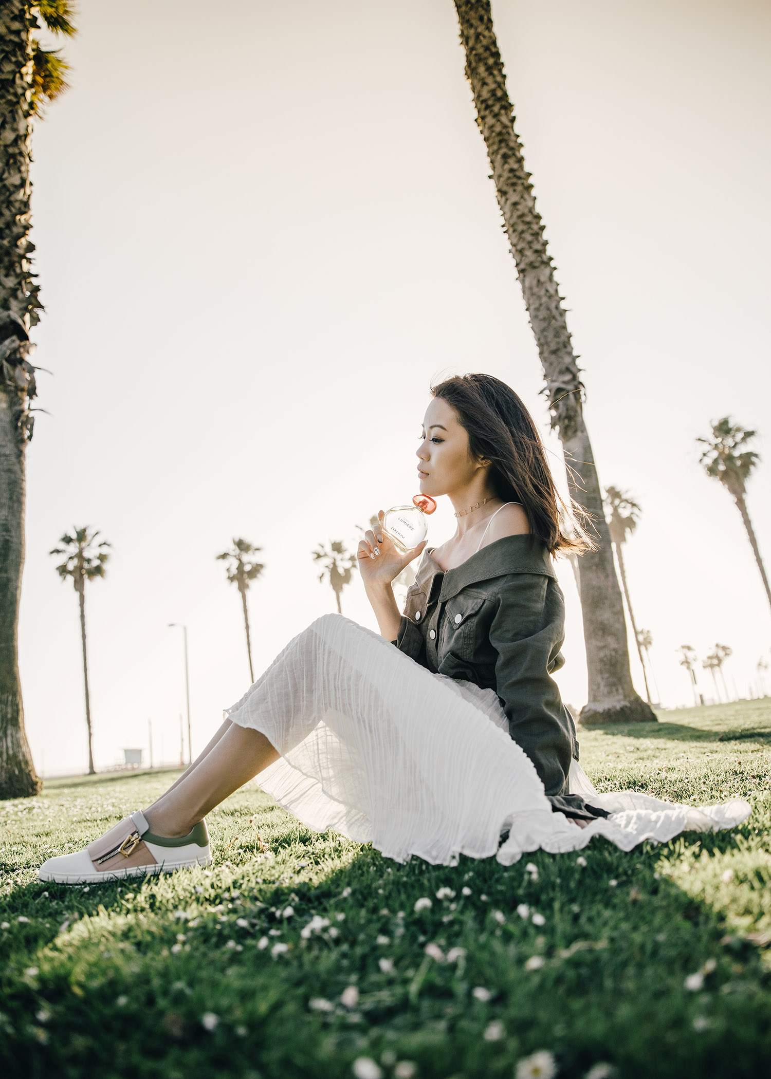 Street style fashion blogger influencer Jenny Tsang of Tsangtastic wearing ROBERT RODRIGUEZ Off Shoulder Jacket, C/MEO COLLECTIVE White Evoke Dress, L'Occitane en Provence Terre de Lumiere and ROGER VIVIER Sneaky Viv, in Los Angeles, Venice, California.