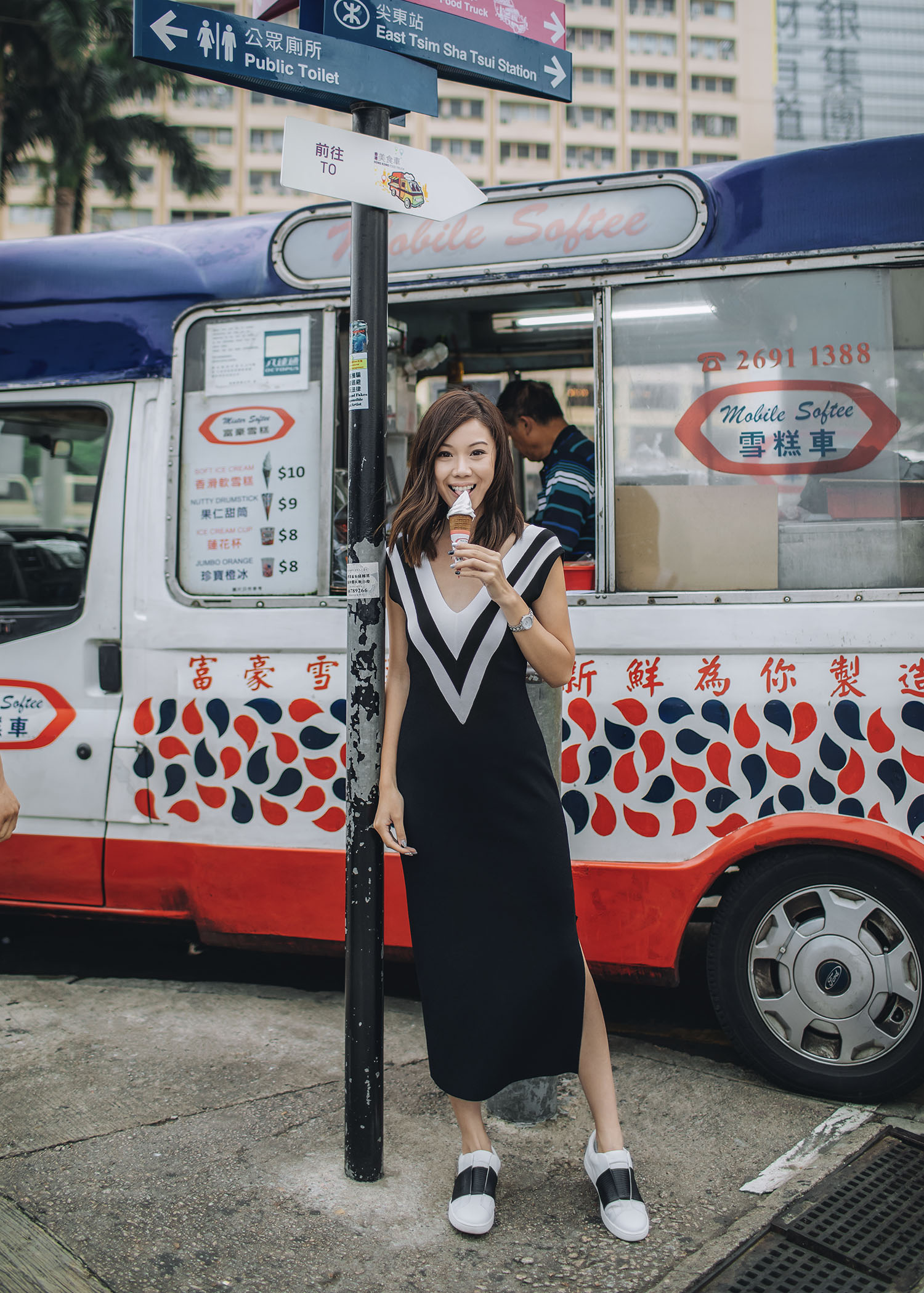 Street style fashion blogger influencer Jenny Tsang of Tsangtastic wearing RAG & BONE Daphne Varsity Sweater Dress and VINCE Sneaker with black bend, in Hong Kong.