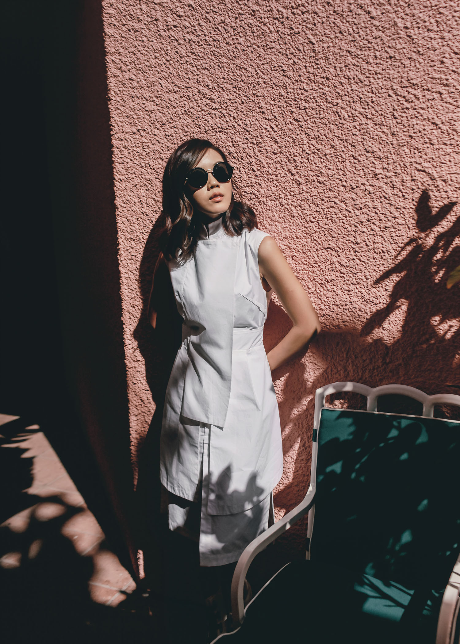 Street style fashion blogger influencer Jenny Tsang of Tsangtastic wearing ACLER Shirt Dress, GUCCI Round Sunglasses, ELLERY zipped platform ankle boots, in Beverly Hills Hotel, Los Angeles, California.