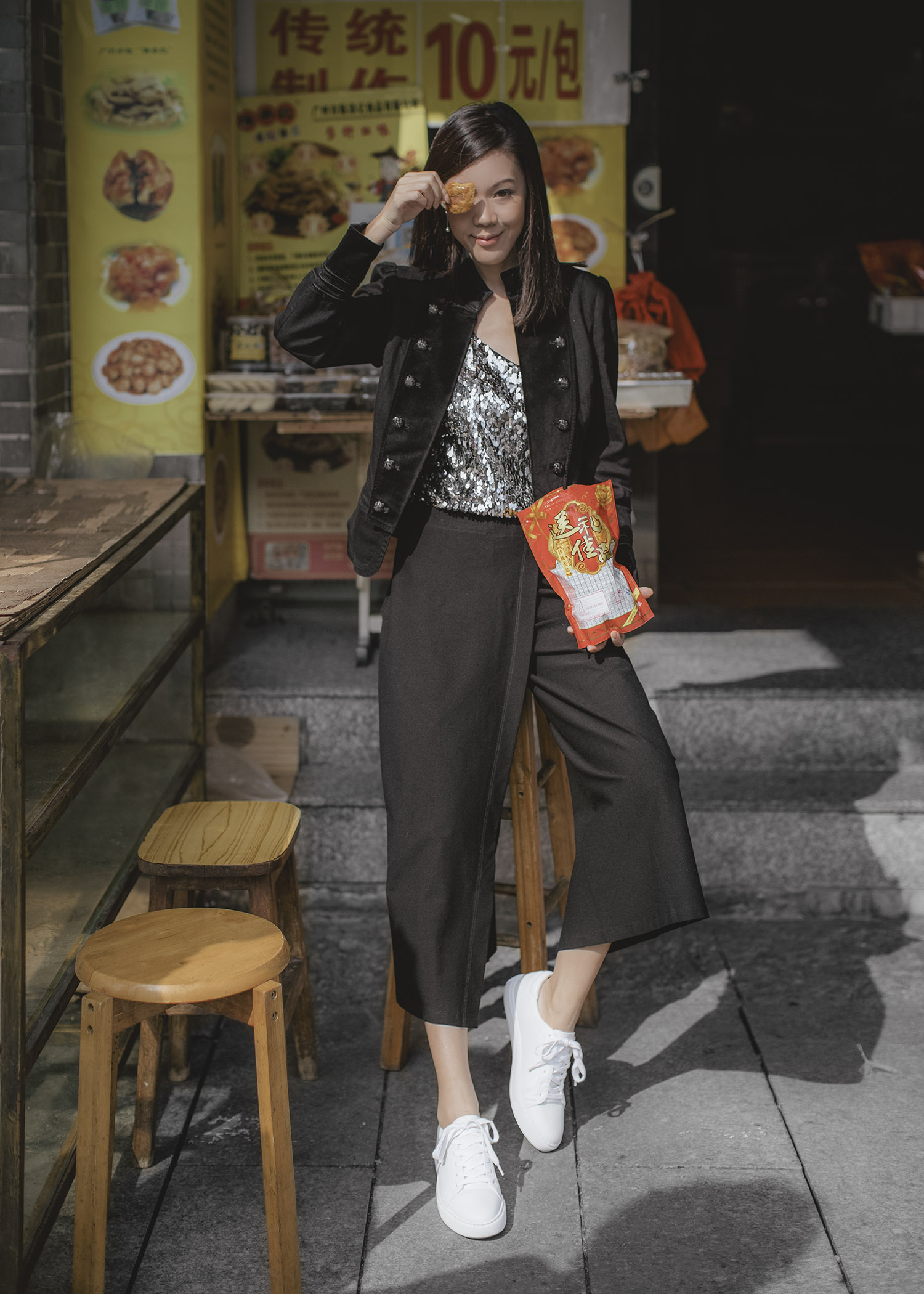 Jenny Tsang of Tsangtastic wearing sequins camisole military blazer asymmetrical culottes and white sneakers
