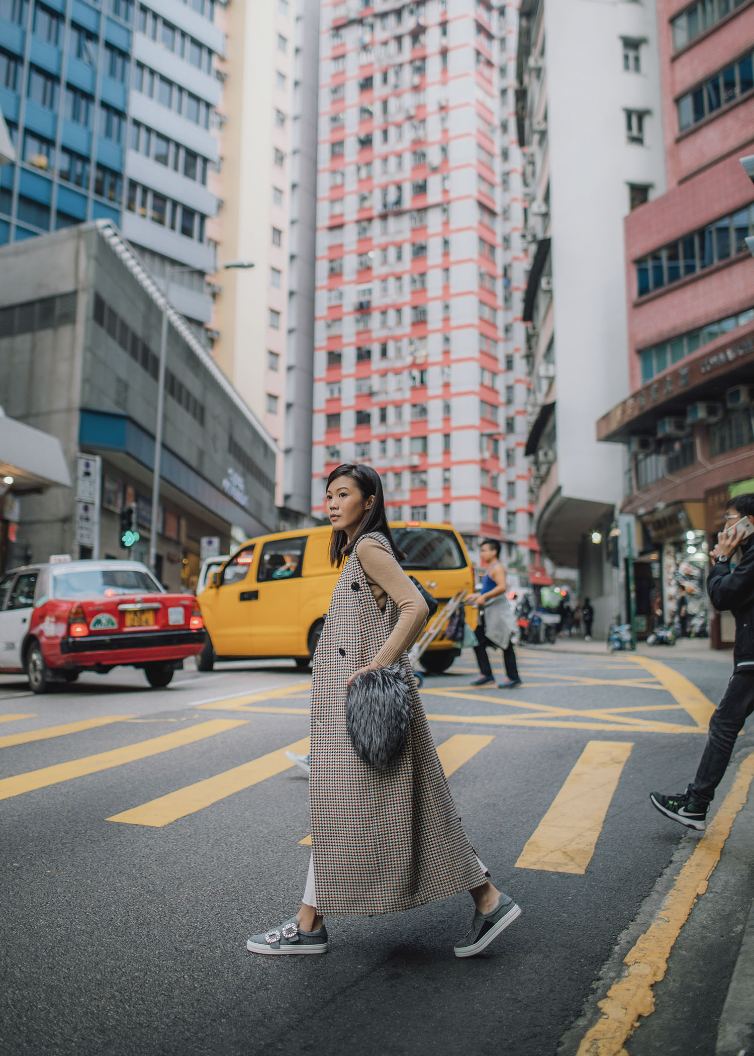 Jenny Tsang of Tsangtastic styling long coat vest in Hong Kong
