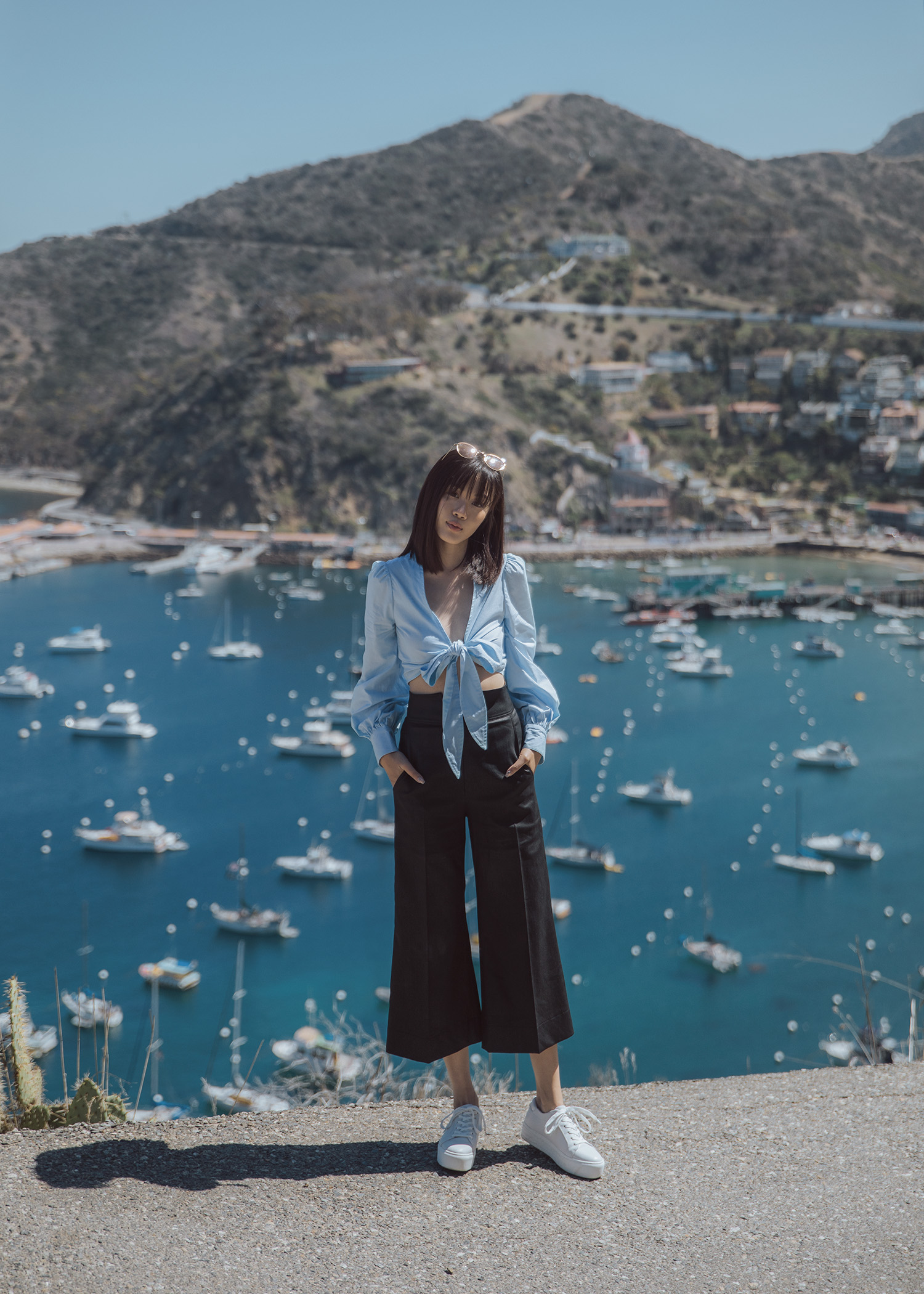 Cropped shirt top culotte flared pants white platform sneakers in Catalina Island