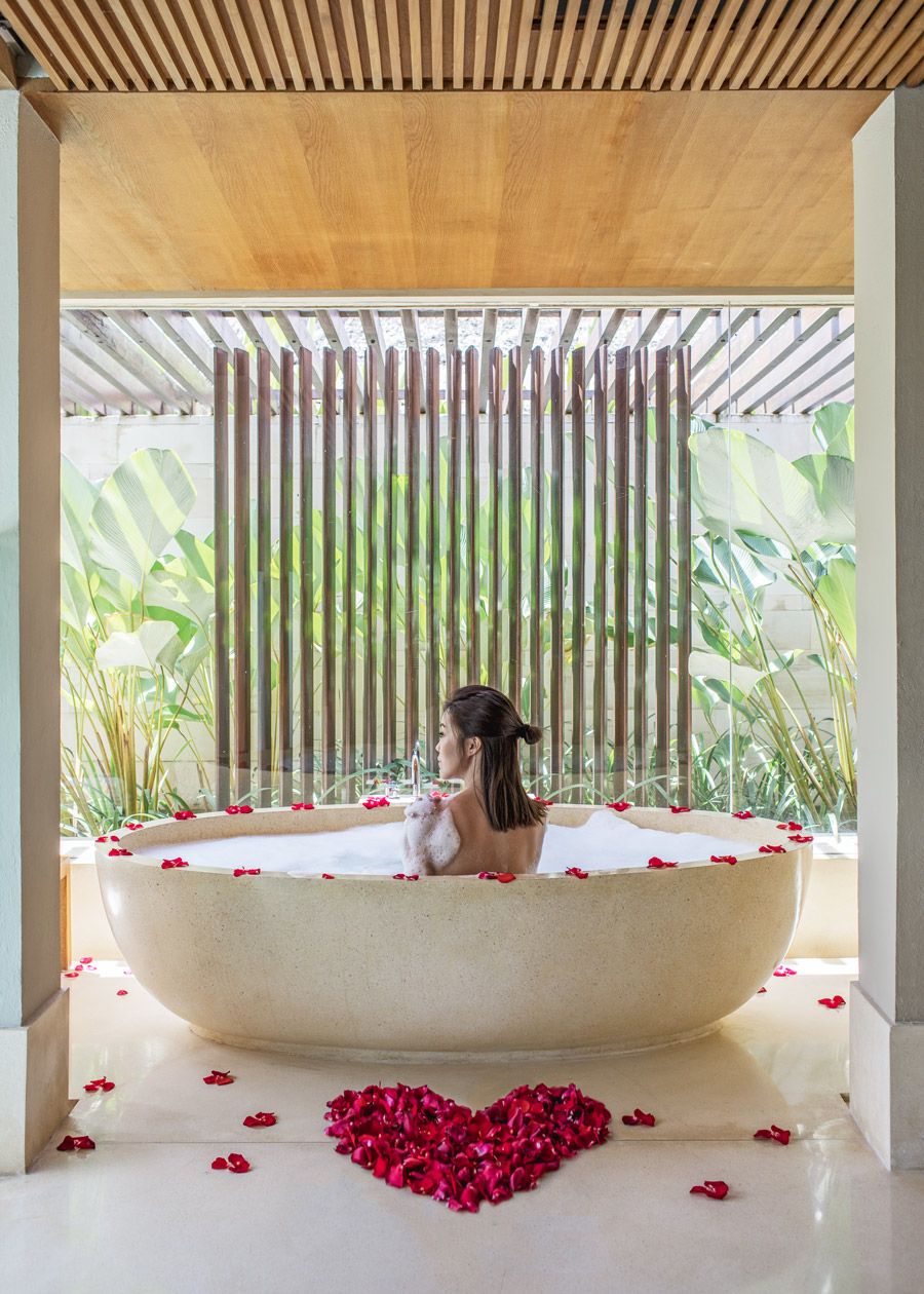 Fashion and travel blogger influencer Jenny Tsang of Tsangtastic traveling in Bali, Indonesia, staying at The Bale, Nusa Dua Bali, enjoying bubble bath.