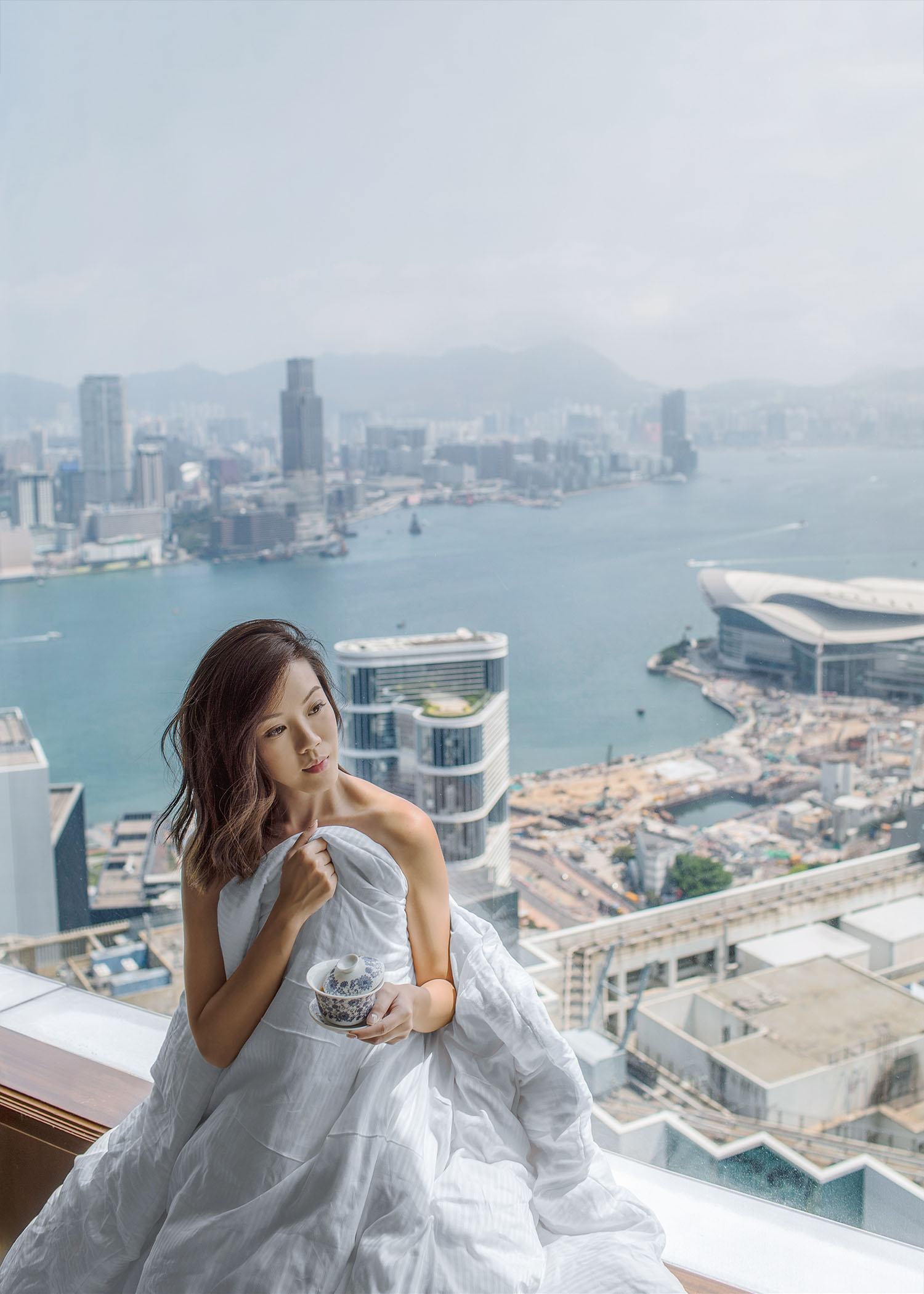 Fashion and travel blogger influencer Jenny Tsang of Tsangtastic traveling in Hong Kong, at the Island Shangri-La Hotel.
