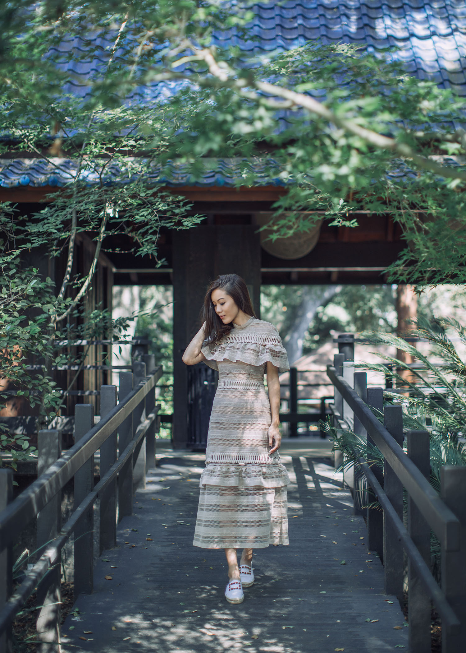 Street style fashion blogger influencer Jenny Tsang of Tsangtastic wearing SELF PORTRAIT Midi Dress, TOCCA Florence Fragrance and ROGER VIVIER Espadrilles, in Los Angeles, California.