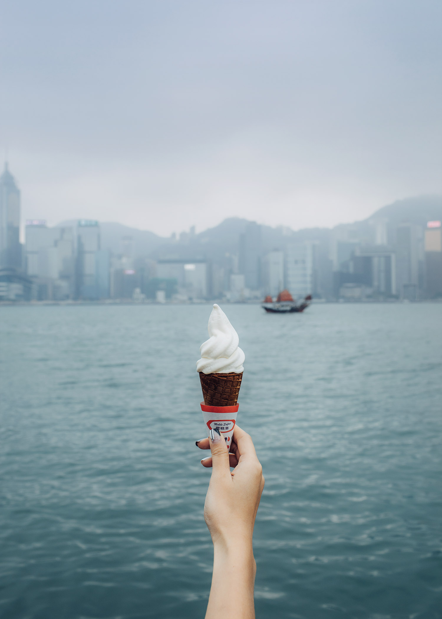 Street style fashion blogger influencer Jenny Tsang of Tsangtastic enjoying ice cream in Hong Kong. Ice Cream with a view.