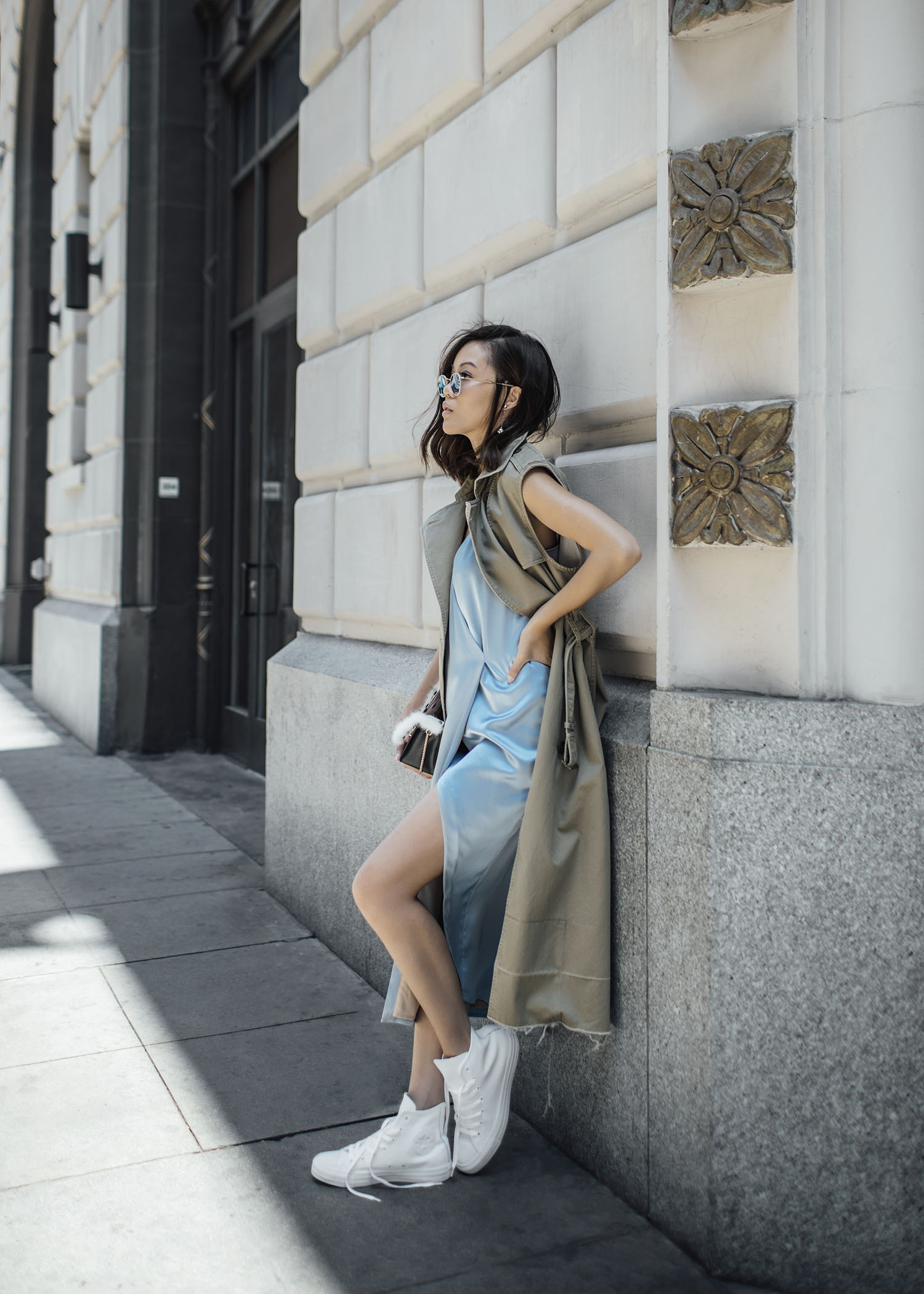 Street style fashion blogger influencer Jenny Tsang of Tsangtastic wearing SALTT Amber Slip Dress from Frilly, LAUTEM I Got Rhythm Bag, GARRETT LEIGHT Sunglasses, CONVERSE Chuck Taylor High Top Sneaker, in Los Angeles, California.