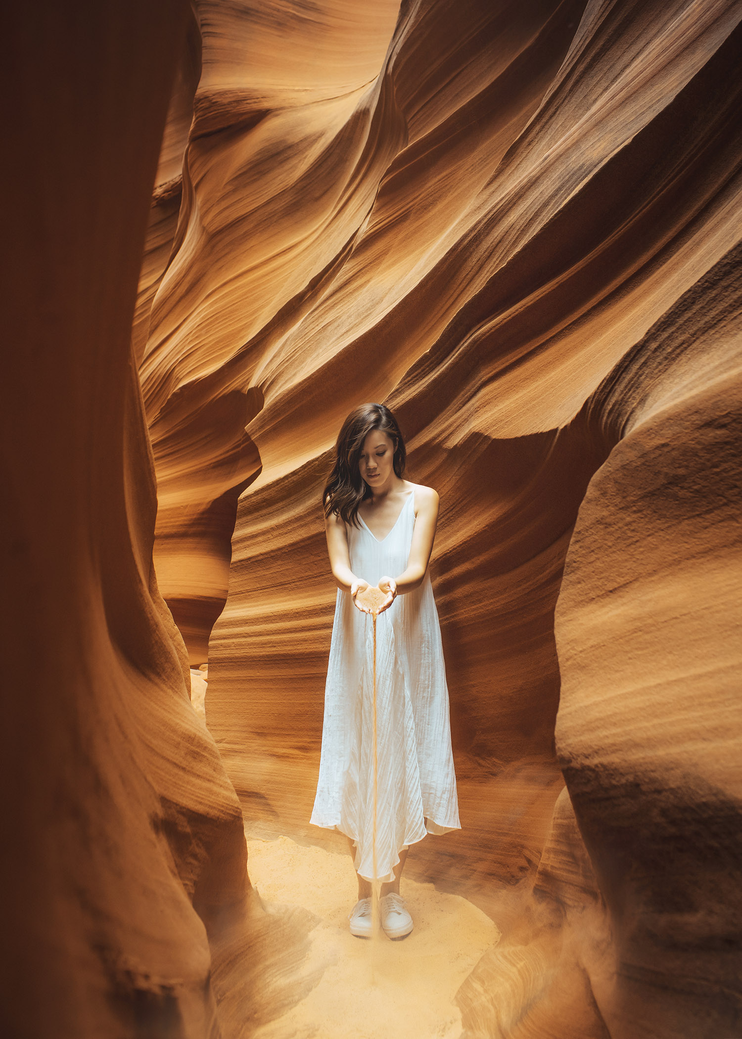 Lifestyle fashion travel blogger Jenny Tsang of Tsangtastic wearing white dress and white sneakers in Antelope Canyon in Arizona
