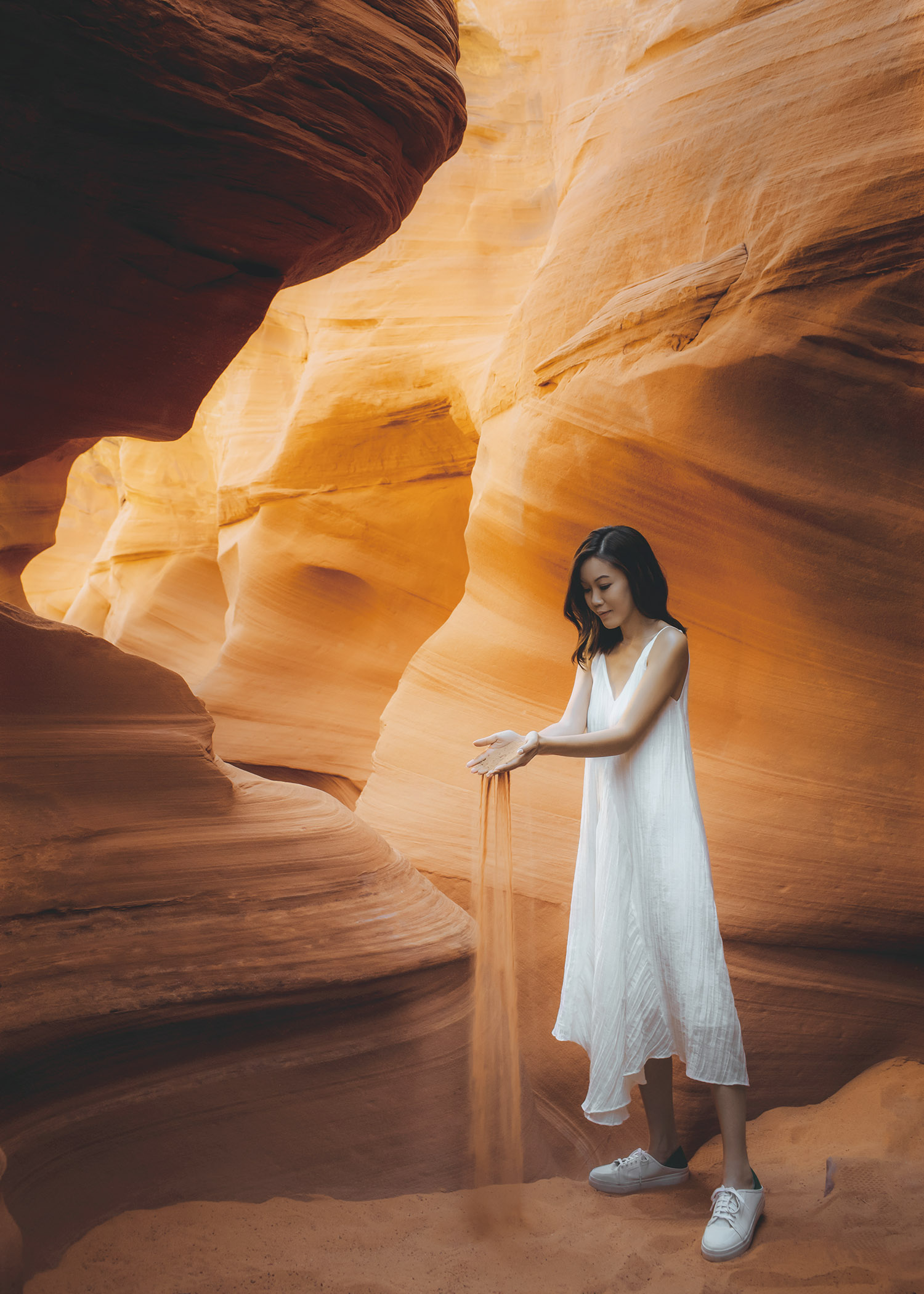 Arizona must visit top 5 Antelope Canyon Must visit Lifestyle fashion travel blogger Jenny Tsang of Tsangtastic wearing white dress and white sneakers in Antelope Canyon in Arizona