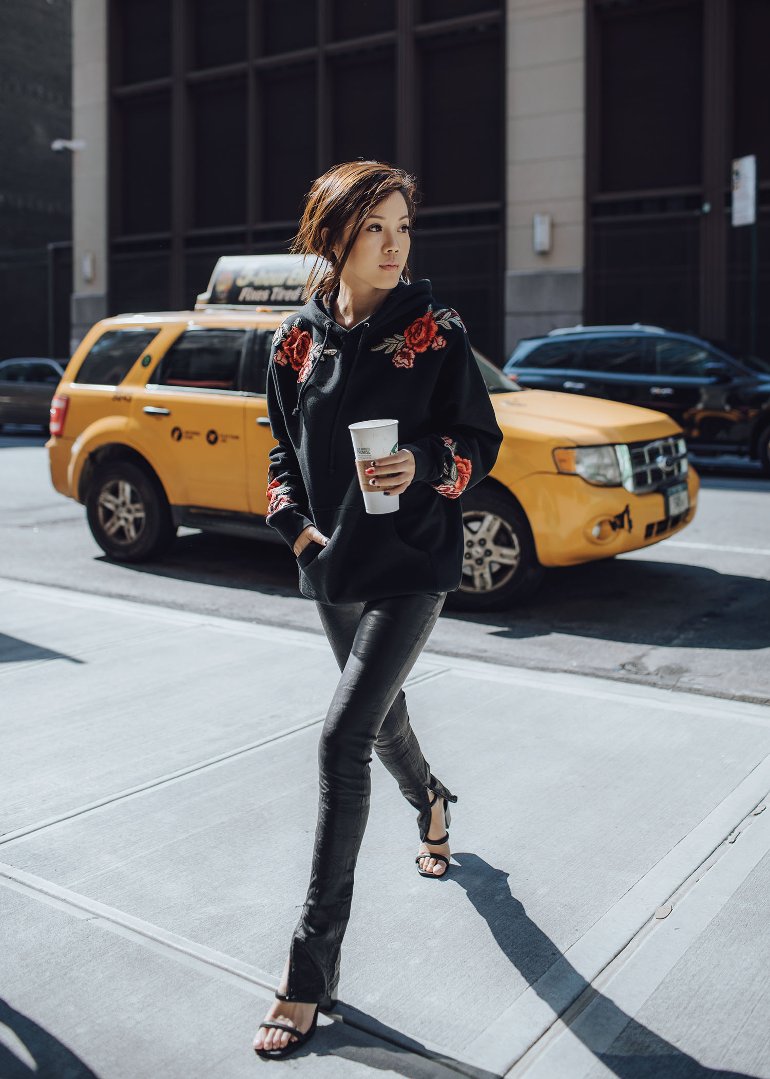 Jenny Tsang of Tsangtastic wearing floral patch sweatshirt ankle zip leather pant velvet military jacket red ruffle sweater and blue leather newsboy cap