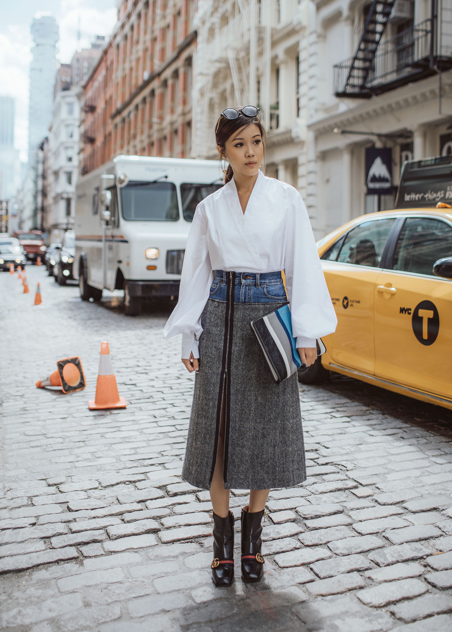 Jenny Tsang of Tsangtastic wearing puffed sleeve white shirt felted wool tweed-denim skirt and pearl block heel boots