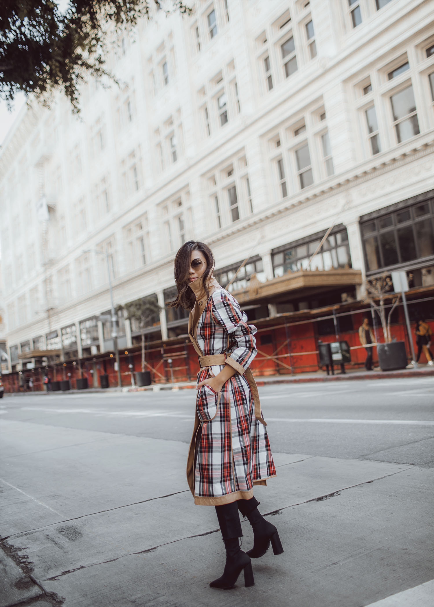 Jenny Tsang of Tsangtastic wearing uniqlo jw anderson trench coat and victoria beckham rounded sunglasses