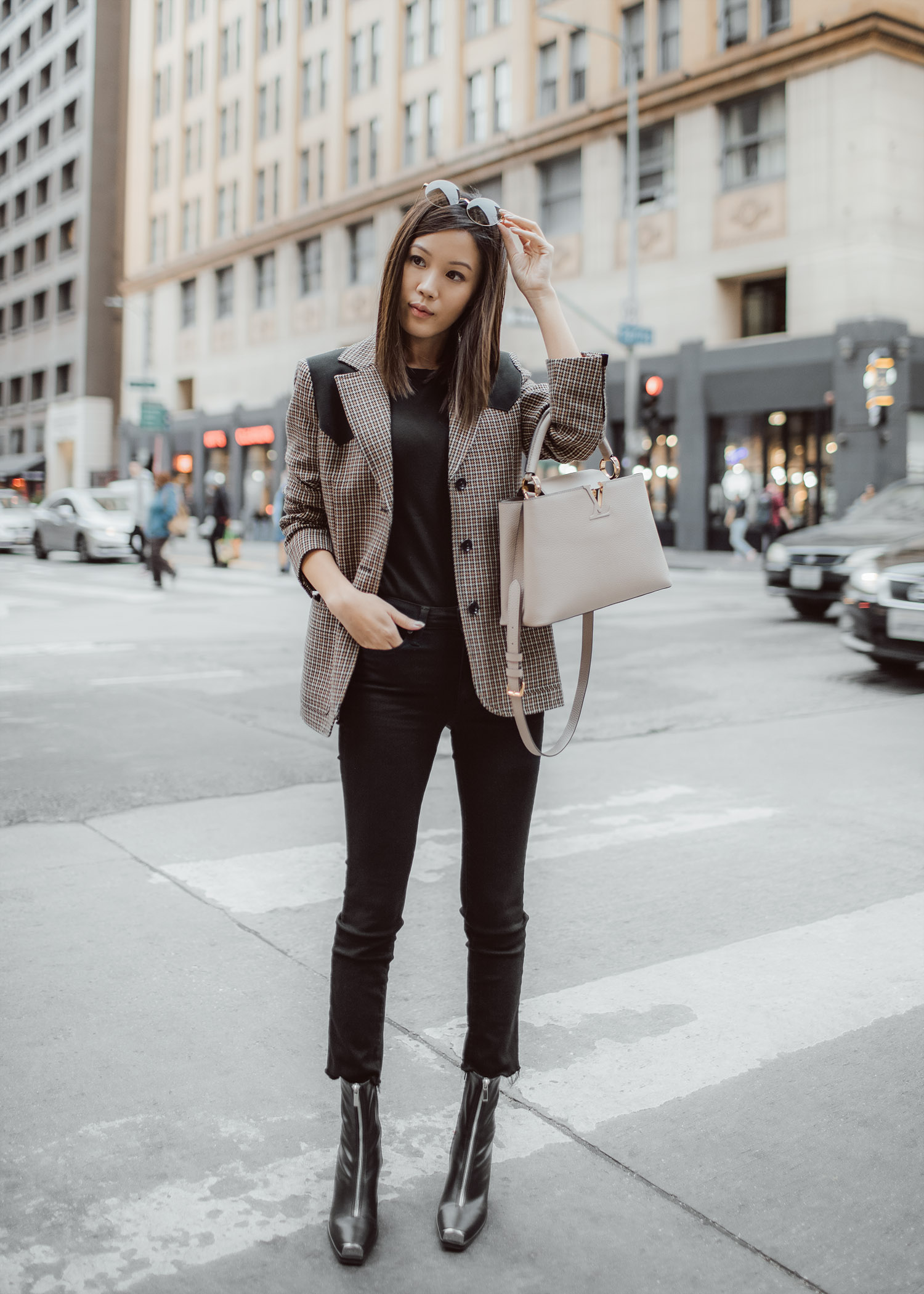 Jenny Tsang of Tsangtastic wearing louis vuitton houndstooth checkered blazer louis vuitton capucines bag in beige and jeffrey campbell Welton Block Heel Boots