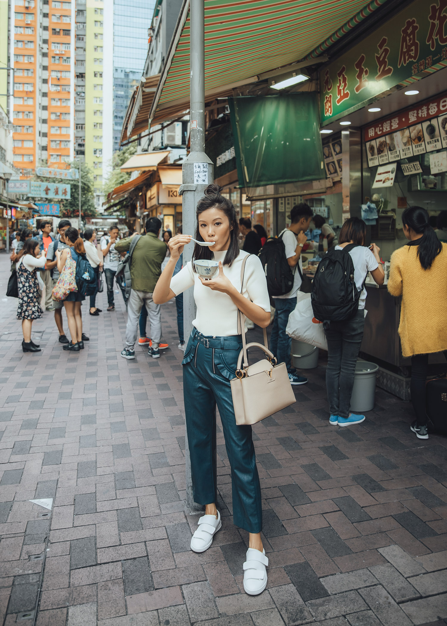 Jenny Tsang of Tsangtastic wearing self portrait ruffle leather pants and acne studios sneakers in Hong Kong