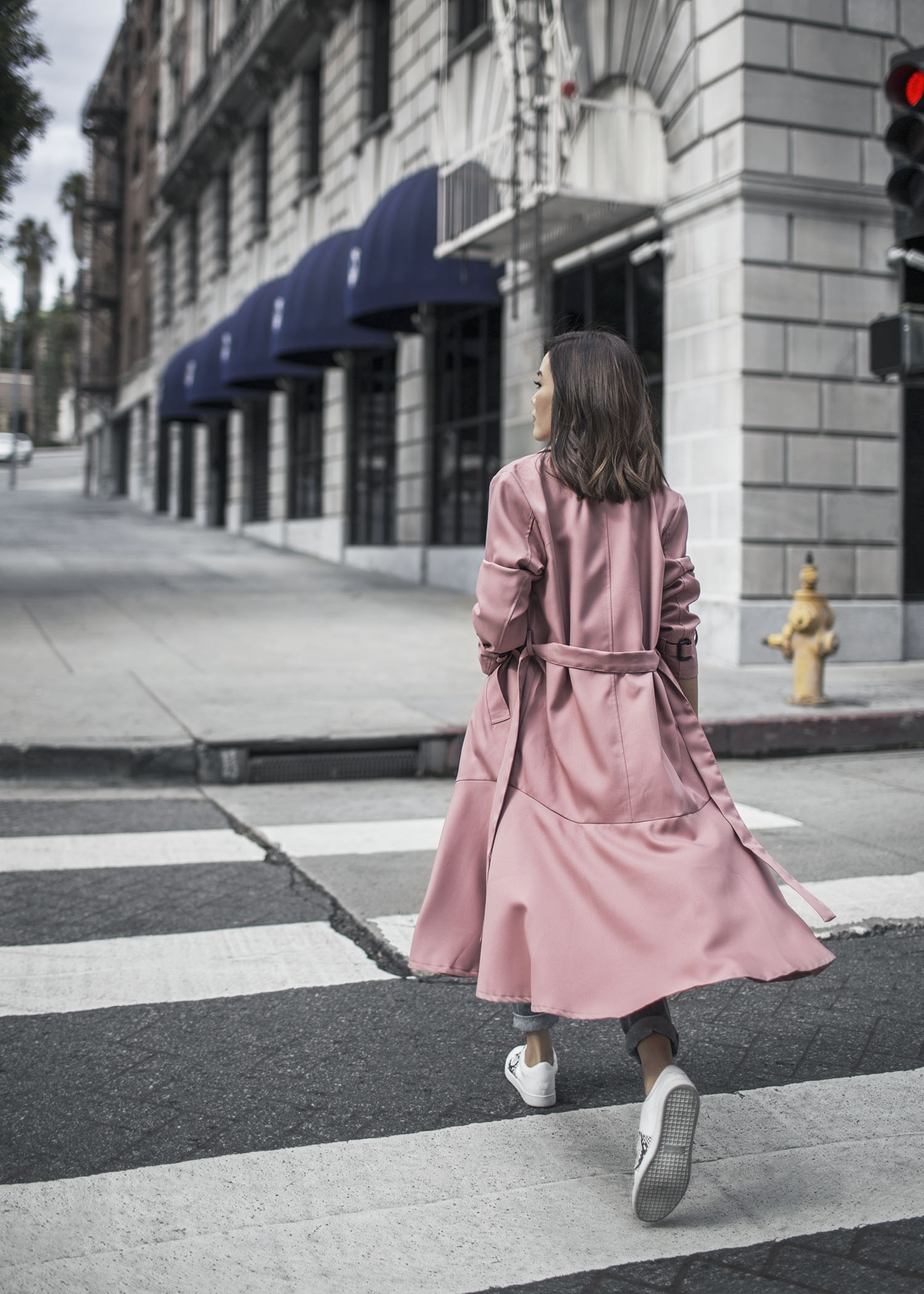 Jenny Tsang of Tsangtastic styling different ways to wear long coats