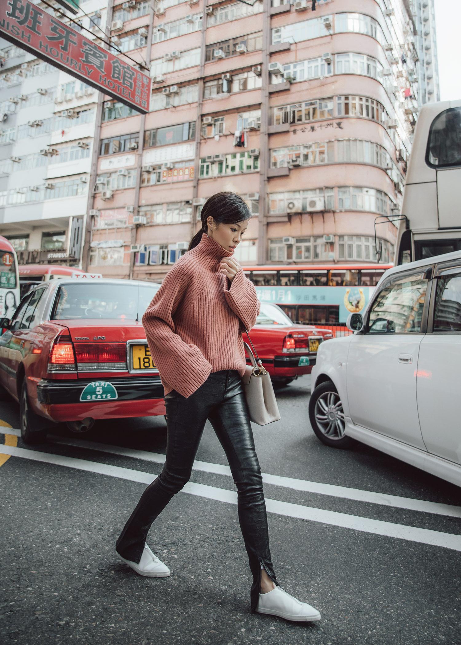 Jenny Tsang of Tsangtastic wearing byTSANG rosy structured knit and leather pants in Mong Kok Hong Kong