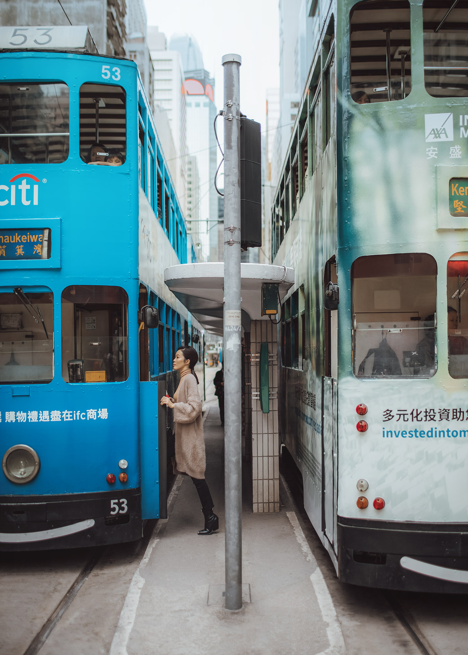 Jenny Tsang of Tsangtastic wearing bytsang fuzzy cardigan coat in Hong Kong Central riding the tram