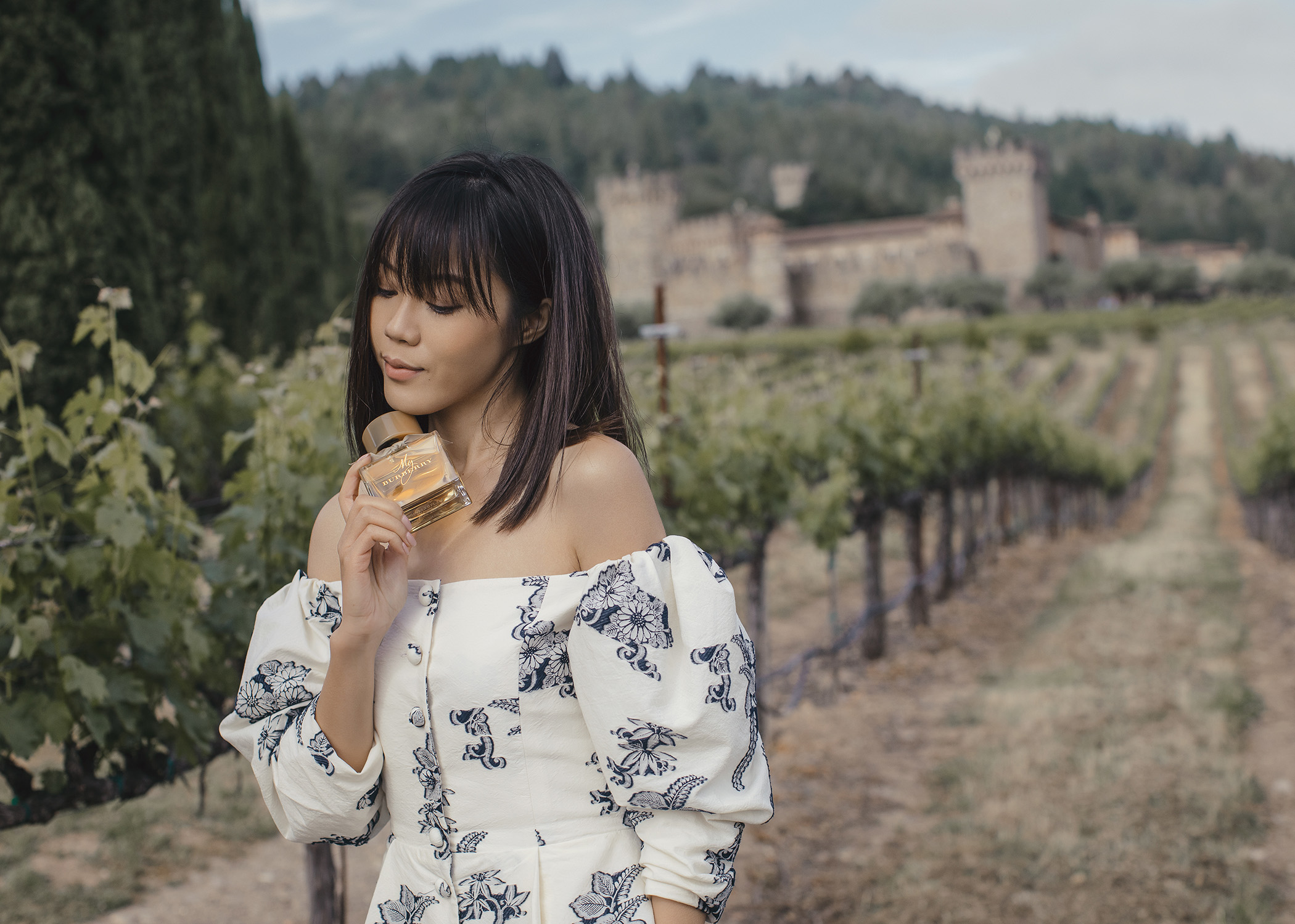 Jenny Tsang of Tsangtastic in Napa Valley castle with Burberry My Burberry Classic My Burberry Blush fragrance wearing Sea NYC dress