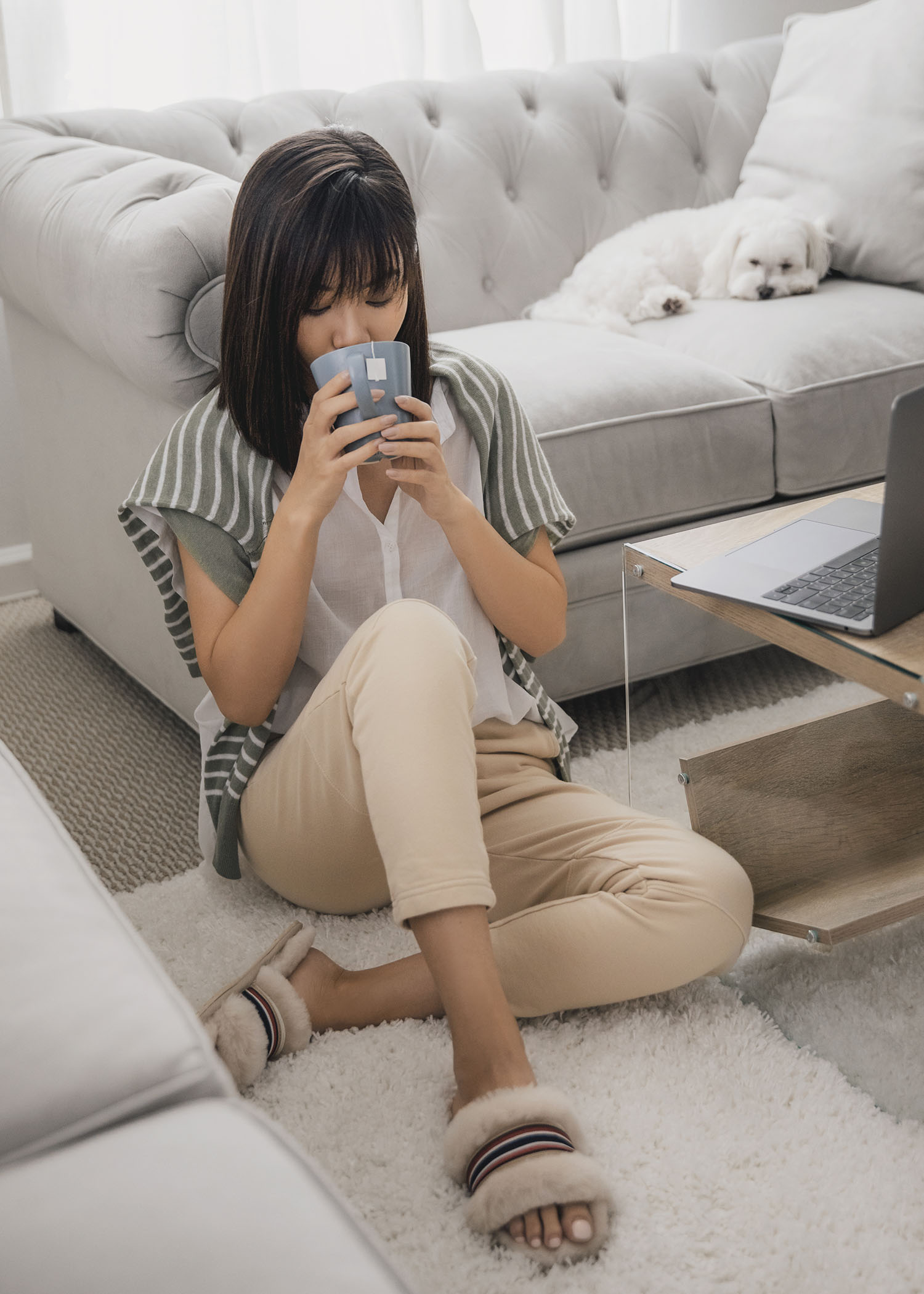 Jenny Tsang of Tsangtastic styling sweater sweatpants outfit with fluffy fuzzy slippers comfortable home outfit