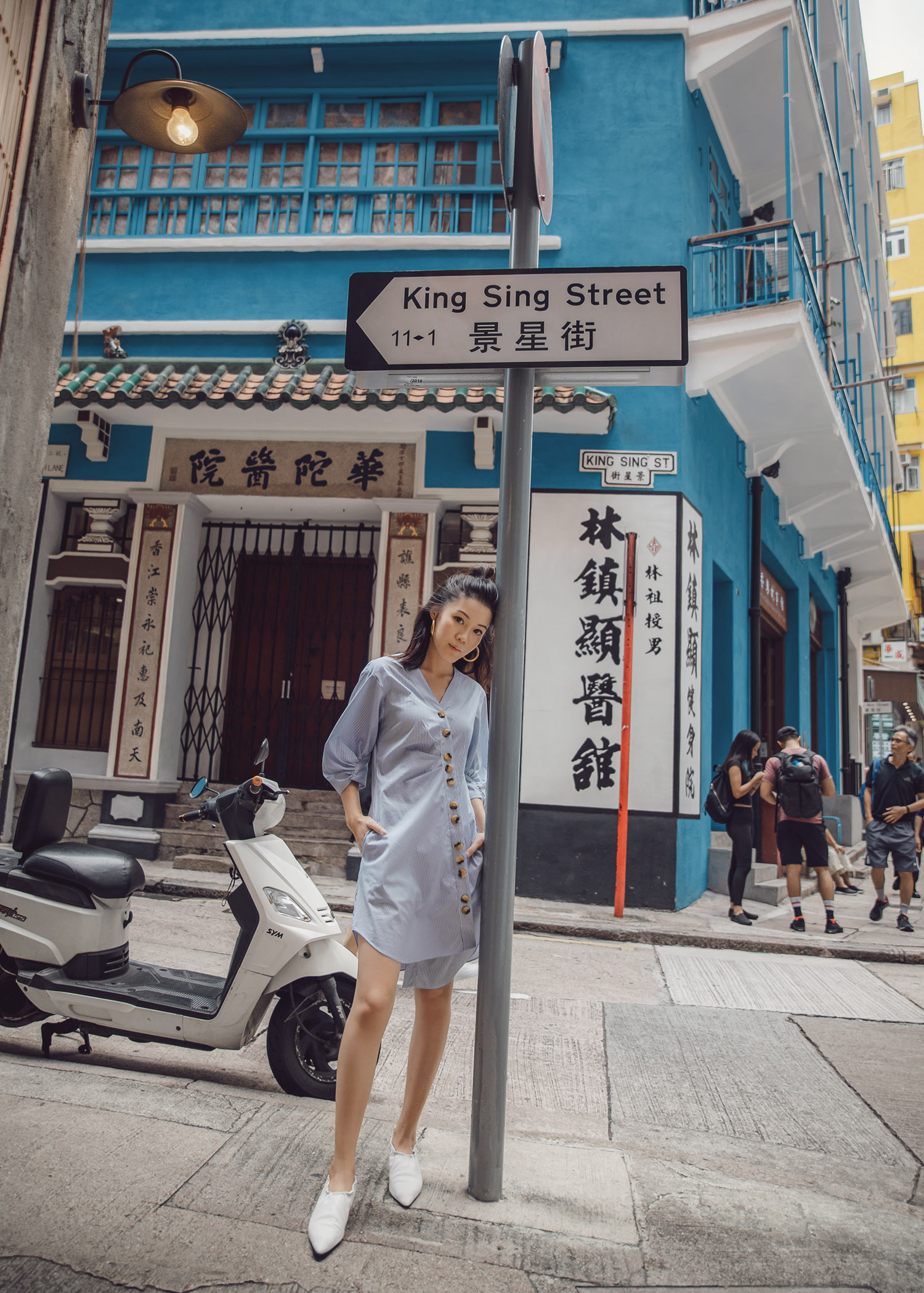 Tibi asymmetrical shirtdress with high-front white pumps in Hong Kong