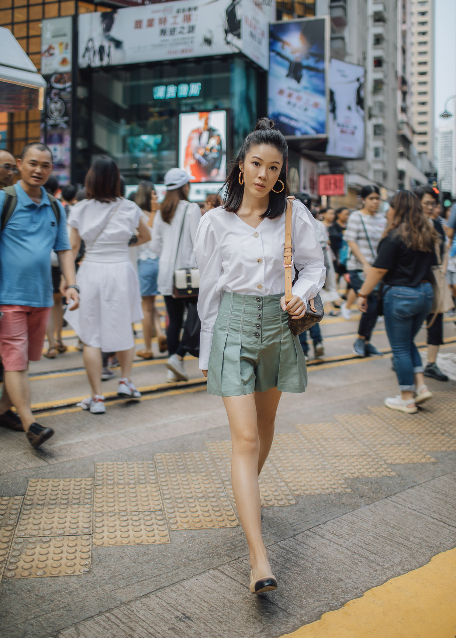 Jenny Tsang of Tsangtastic wearing Louis Vuitton bumbag styling belt bag in Hong Kong