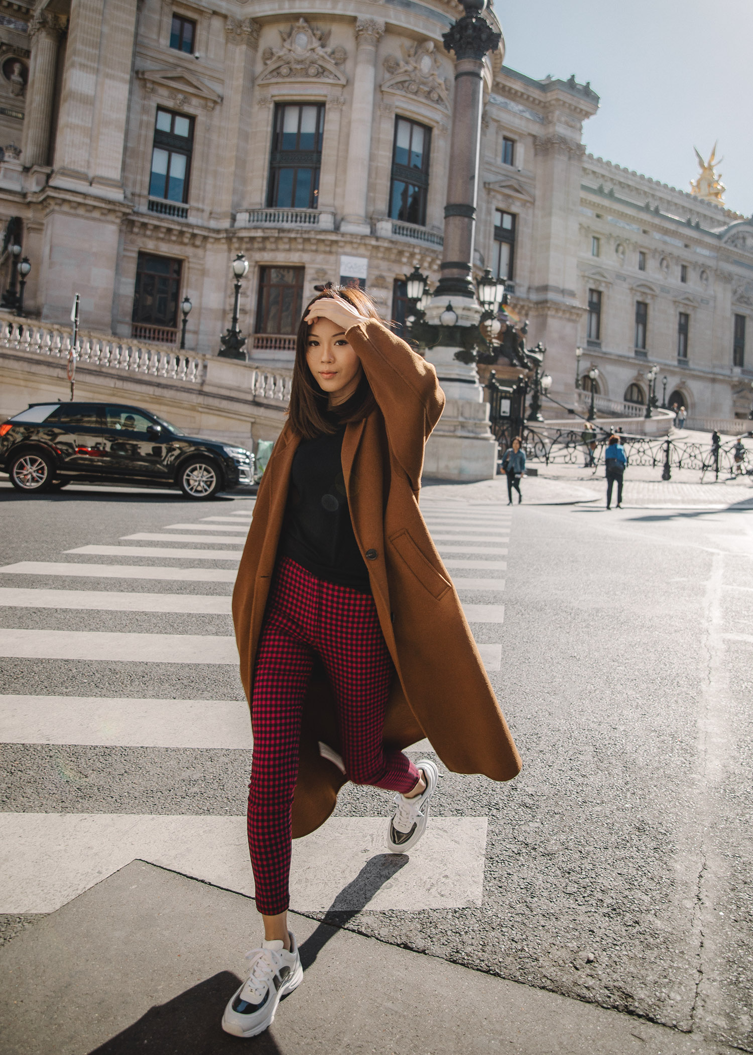 Jenny Tsang of Tsangtastic wearing brown oversized coat in Paris