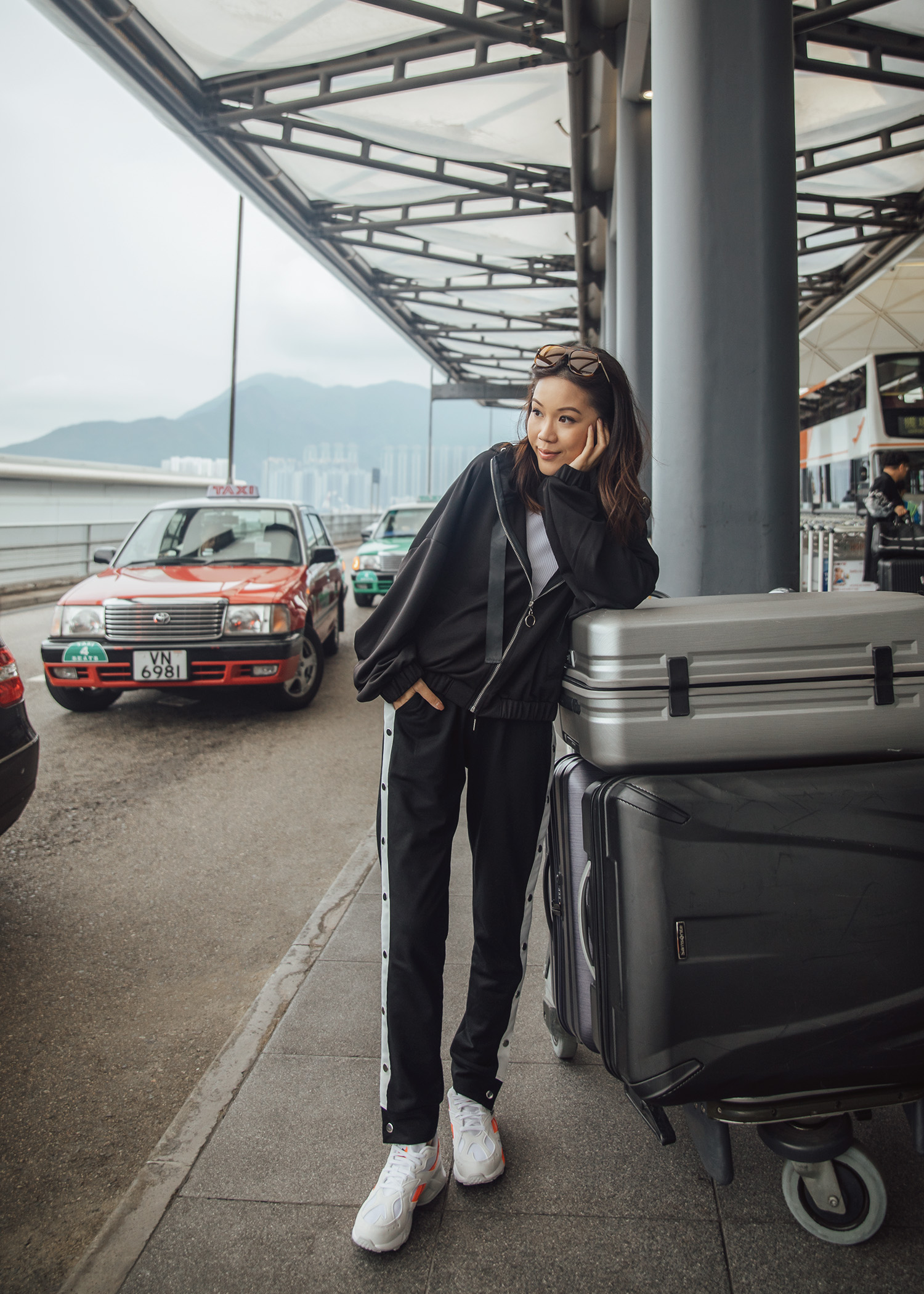 Jenny Tsang of Tsangtastic wearing airport activewear outfit in Hong Kong