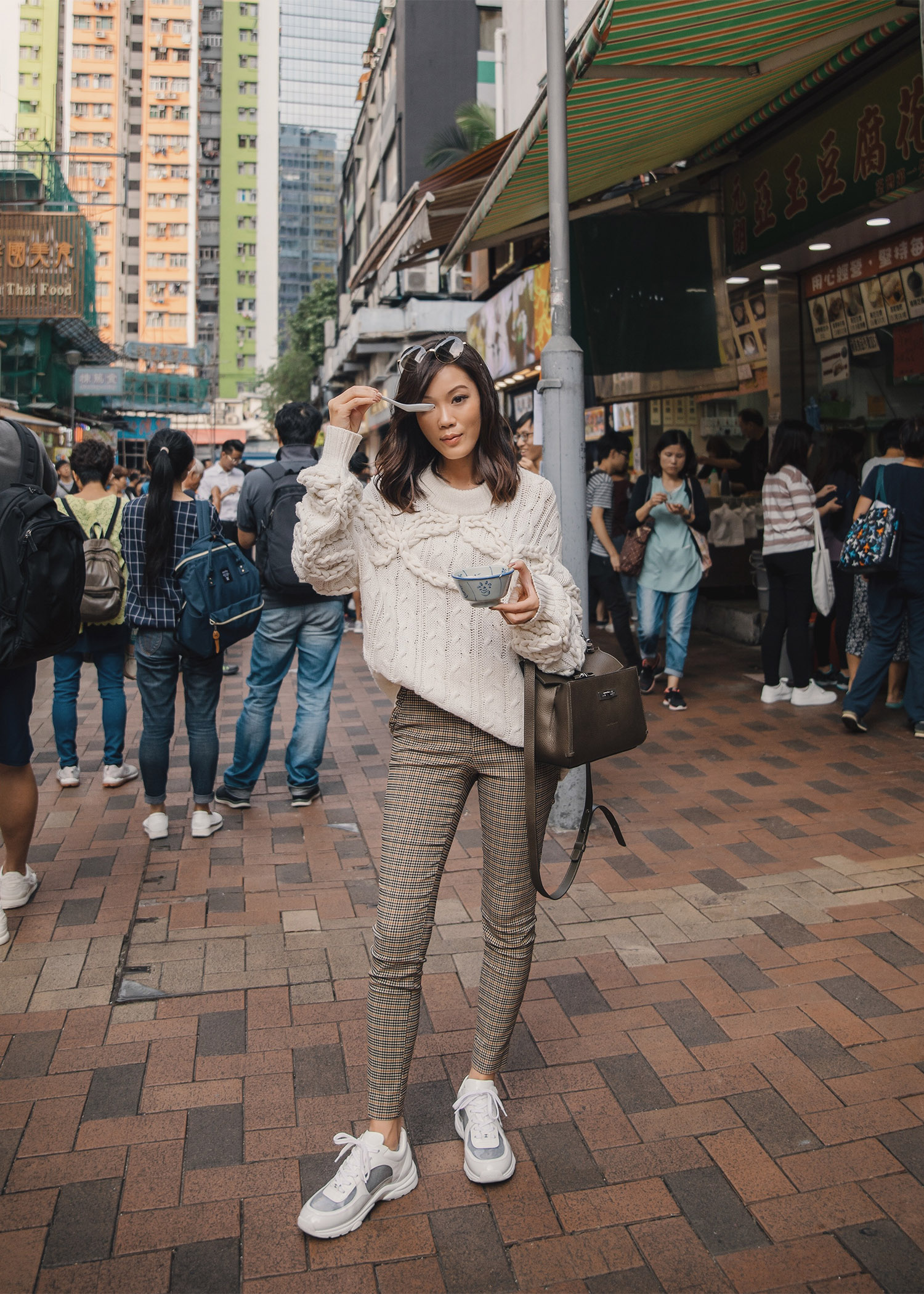 Jenny Tsang of Tsangtastic wearing designers remix cable knit sweater plaid skinny pants chanel sneakers longchamp MADELEINE bag in Hong Kong