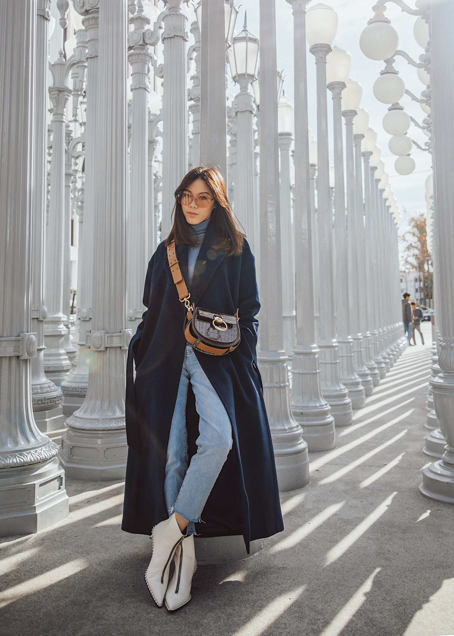Jenny Tsang of Tsangtastic wearing long wool coat with jeans with alexander wang white point toe boots and chloe tess bag in brown
