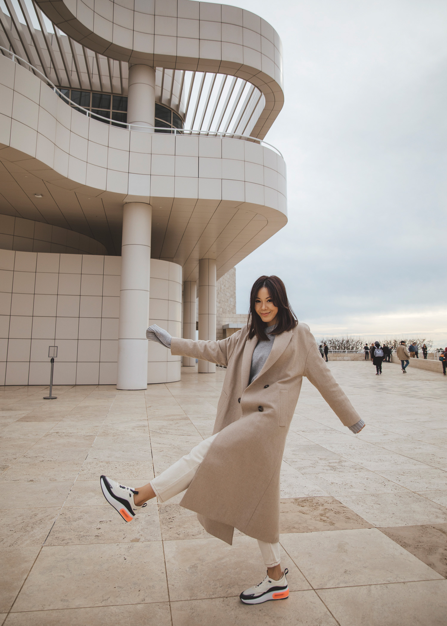 Jenny Tsang of Tsangtastic wearing long coat and nike air max dia monochromatic sneaker outfit
