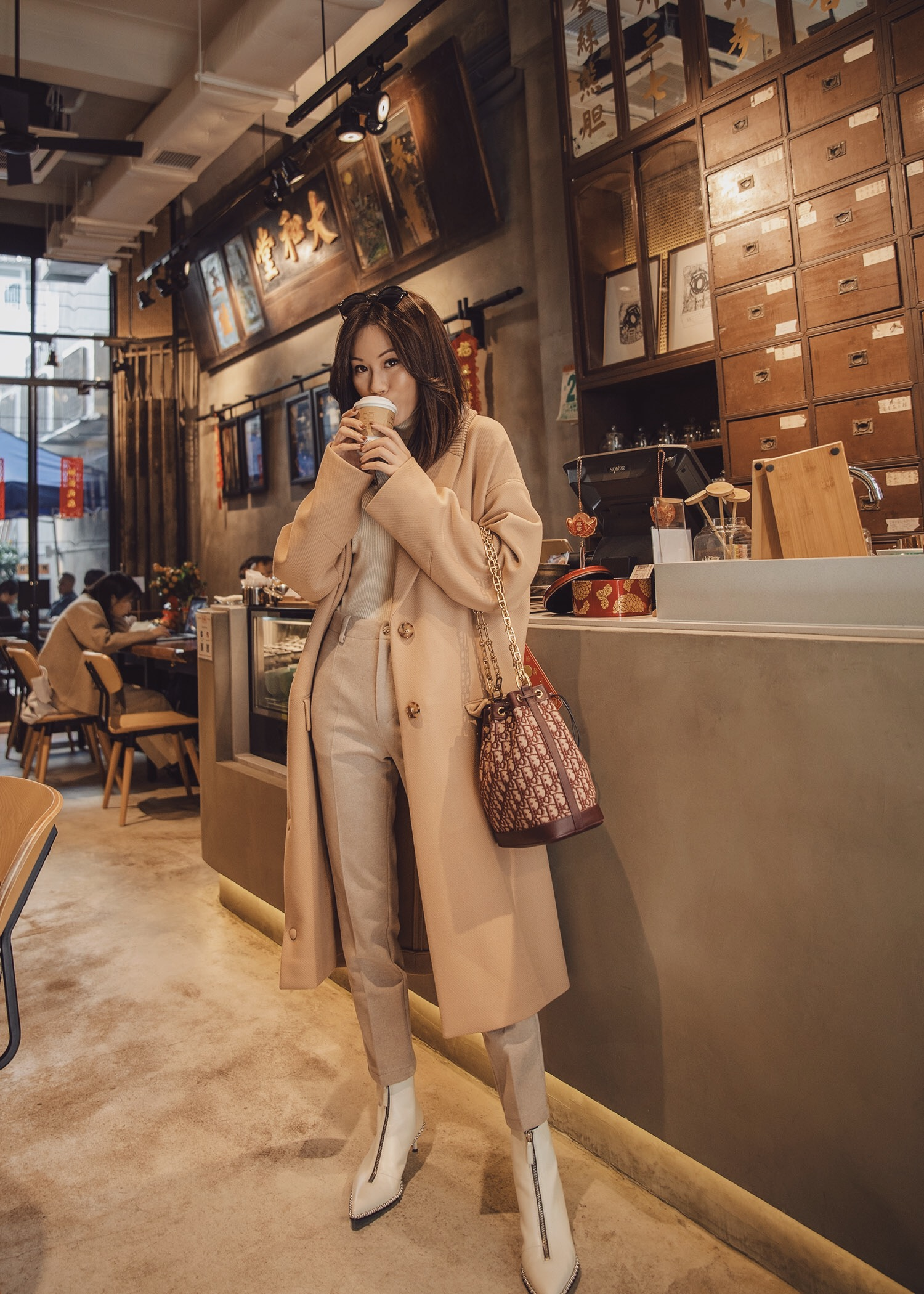Jenny Tsang of Tsangtastic wearing Stella McCartney beige coat Dior oblique bucket bag all beige outfit