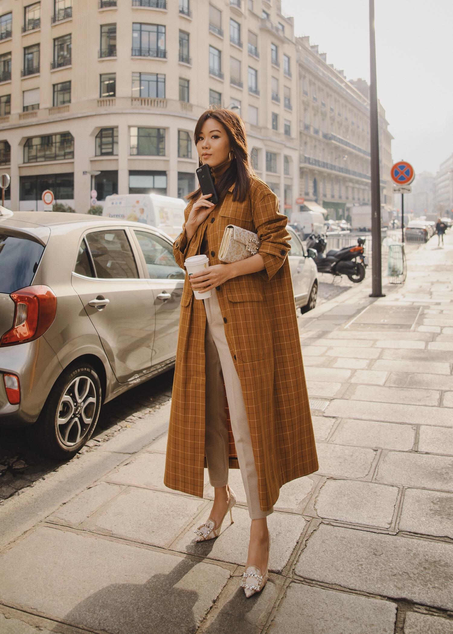 Jenny Tsang of Tsangtastic wearing Sea plaid trench coat with roger vivier pumps roger vivier clutch Paris Fashion Week