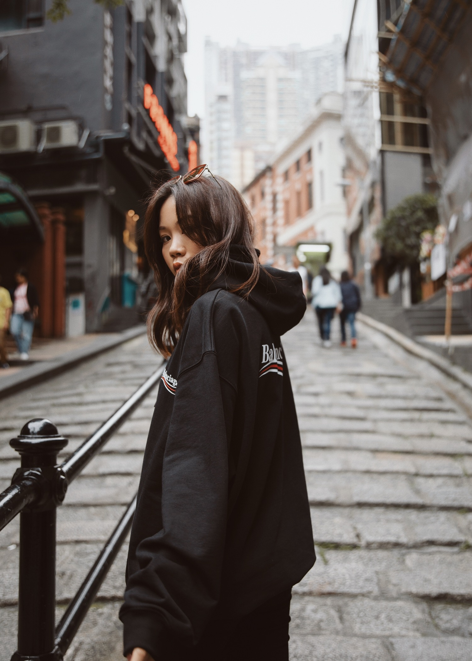 jenny tsang wearing brownsfashion balenciaga hoodie sweatshirt and boyy ankle boots in hong kong