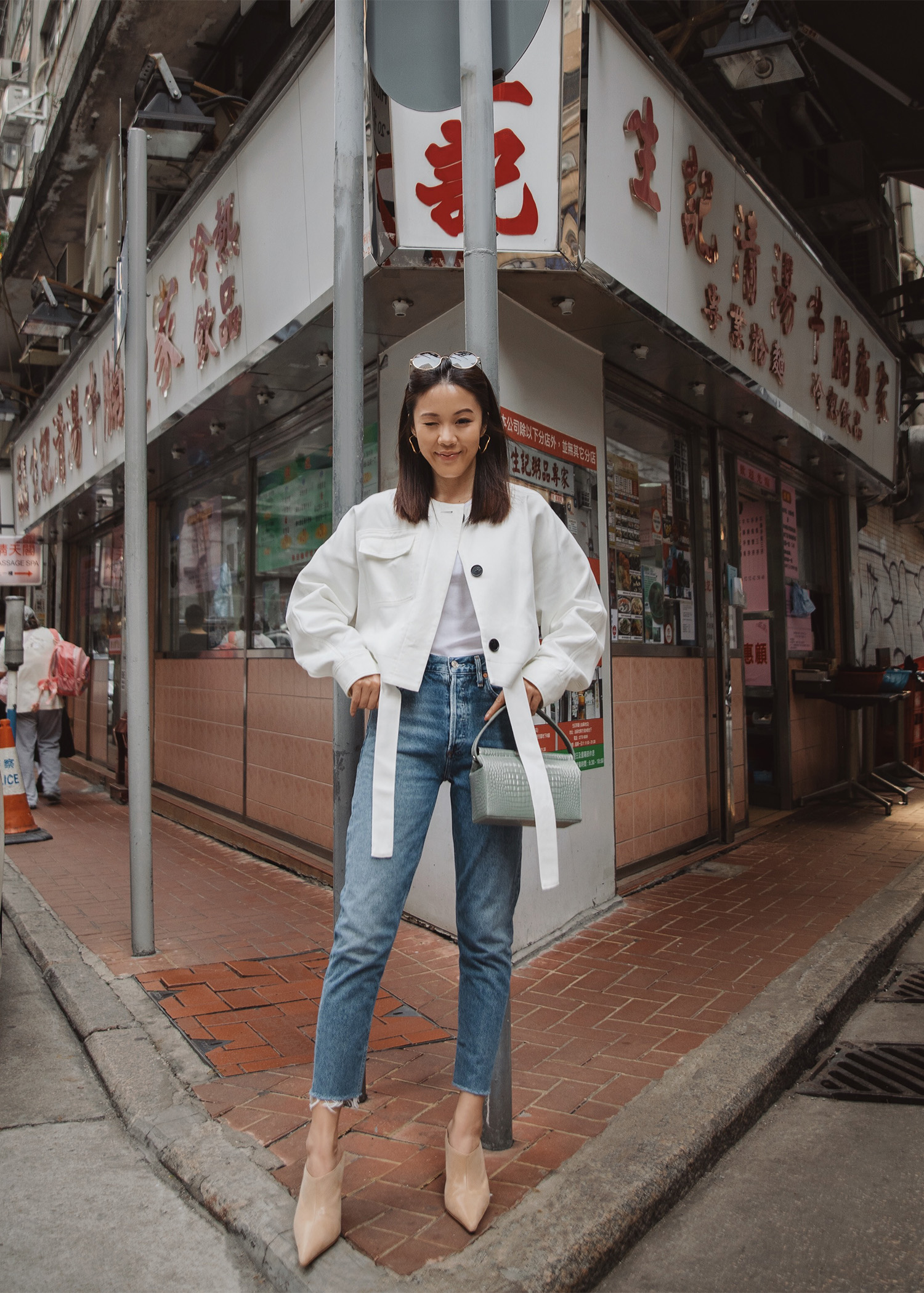 jenny tsang wearing cropped jacket and agolde jeans from net-a-porter in hong kong